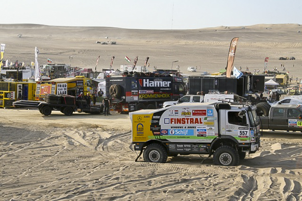 Pisco: two trucks buried in the pits. Check out the trailer in the background!