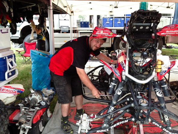 Dakar 2013: Mechanic Pete Wilhelms with Paul Smith's stage winning TRX700XX.
